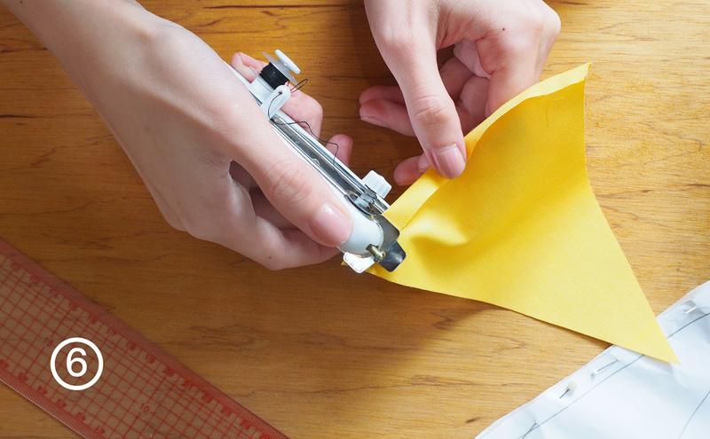 步驟6-上方的1公分往下折,用縫紉機或手縫的方式,縫出旗子穿線的開孔